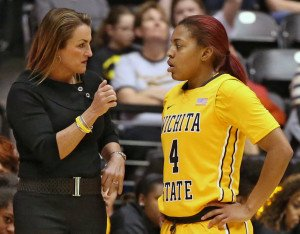 Coach Jody Adams talks to Diamond Lockhart during a pause in game action. Photo by Steve Adelson.
