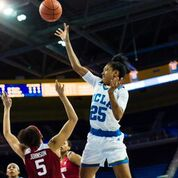 Monique Billings puts up two of her 12 points against Stanford. She lead a balanced Bruin attack, with four players in double figures. Photo by Percy Anderson.