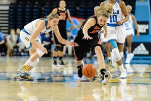 UCLA's Kari Korver and Oregon State's Katie McWilliams battle for the ball. Photo by Percy Anderson.