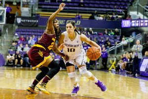 Kelsey Plum drives past ASU's Elisha Davis. Photo by Scott Eklund/Red Box Pictures.