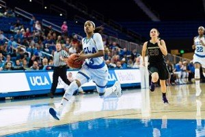 UCLA's Jordin Canada leads the fast break against Washington to score. Photo by Percy Anderson.