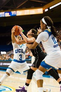 Washington's Kelsey Plum is fouled. Photo by Percy Anderson.