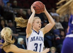 UMaine captain Liz Wood looks to pass. Photo courtesy of UMaine Athletics.