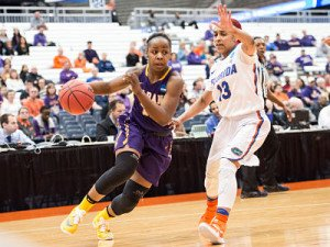 Imani Tate drives against Florida's Cassie Peoples. Tate's 28 points propelled UAlbany past the Gators in NCAA Tournament first-round action. Photo by Bill Ziskin.