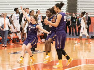 UAlbany players celebrate their upset win over Florida Friday. Photo by Bill Ziskin.