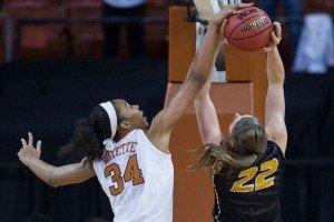 Imani Boyette blocks a shot. Photo courtesy of Texas Athletics.