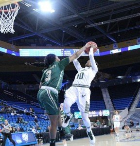 Courtney Williams' shot is defended. Photo by Benita West/T.G.Sportstv1