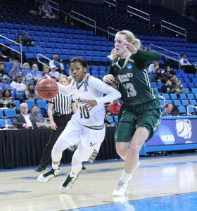 Courtney Williams drives to the hoop. Photo by Benita West/T.G.Sportstv1