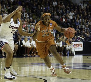 UConn's Morgan Tuck (30) attempts stop the drive by Texas's Ariel Atkins, who scored 19 points in the Huskies' win. Photo by Robert L Franklin.