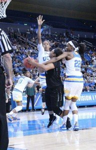 UCLA blocks Hawaii's Destiny King. Photo by Benita West/T.G.Sportstv1