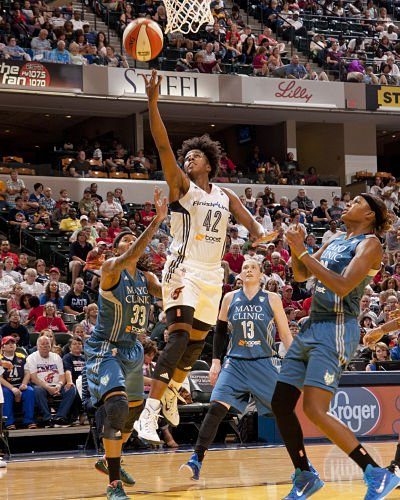 Fever guard Shenise Johnson scores against the Lynx's Seimone Augustus, Lindsay Whalen and Rebekkah Brunson in the WNBA Championship series last October. Photo courtesy of the Indiana Fever.
