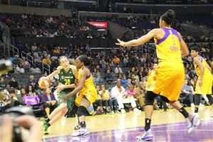 Breanna Stewart drives into the lane against Nneka Ogwumike. Photo by Benita West/T.G.Sportstv1.