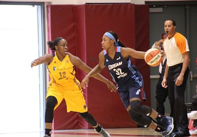 Bria Holmes tries to advance past Chelsea Gray. Photo by Benita Wright/TGSportsTV1.