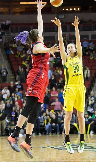 Breanna Stewart shoots a three-pointer over Stefanie Dolson to cut the Mystics lead to 83-82. Despite her great shot the Storm fell in overtime 84-82. Photo by Neil Enns/Storm Photos.