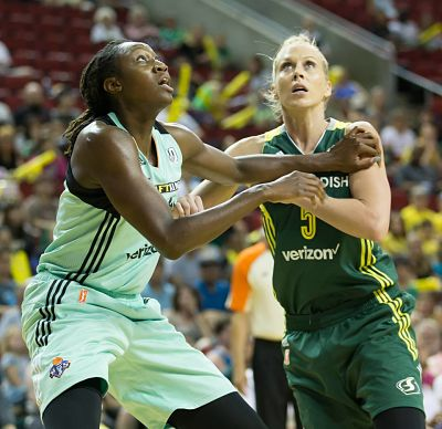 Tina Charles and Abby Bishop battle for position under the basket. Photo by Neil Enns/Storm Photos.