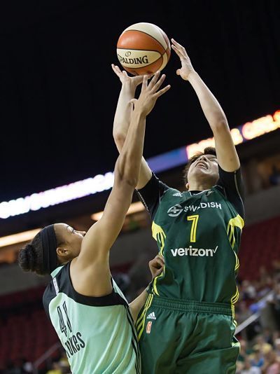 Ramu Tokashiki shoots over the Liberty's Kiah Stokes. Photo by Neil Enns/Storm Photos.