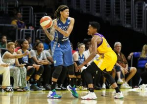 Seimone Augustus looks to pass around Alana Beard. Photo by Jevone Moore/Full Image 360.