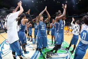 The Minnesota Lynx celebrate breaking the WNBA record for most consecutive wins to start a season. Photo by David Sherman/NBAE via Getty Images, courtesy of Minnesota Lynx.