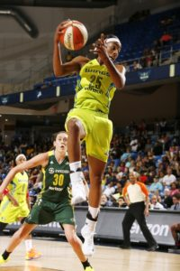 Glory Johnson collects a rebound against the Seattle Storm. Photo by Layne Murdoch/NBAE/Getty Images.