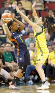 Sue Bird applies tough defensive pressure to the Sun's Jasmine Thomas. Photo by Neil Enns/Storm Photos.