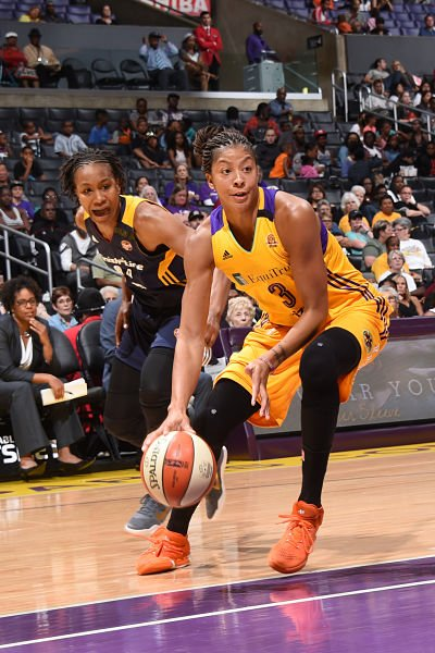 Candace Parker handles the ball against Tamika Catchings. Photo by Andrew D. Bernstein/NBAE via Getty Images.