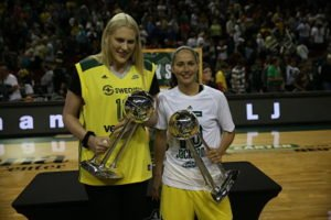 Lauren Jackson and Sue Bird hold the two WNBA Championship trophies they helped the Seattle Storm win. Photo by Stormbasketball.