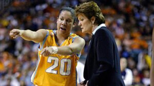 Kara Lawson and Pat Summitt discuss play during the NCAA Championship game in 2003. Photo by Elsa/Getty Images.