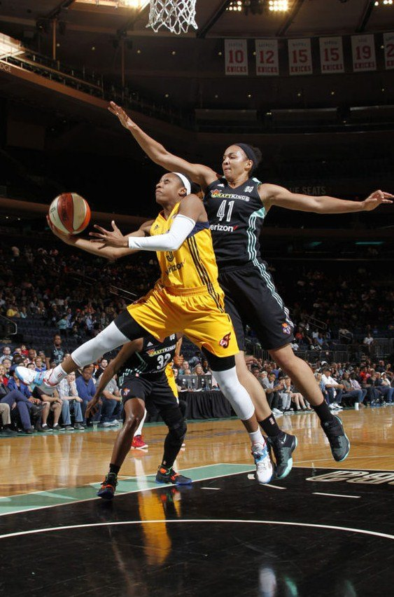 Liberty center Kiah Stokes defends Fever guard Tiffany Mitchell. The Liberty rank second in WNBA home attendance so far this season. Photo by MSG Photo Services.