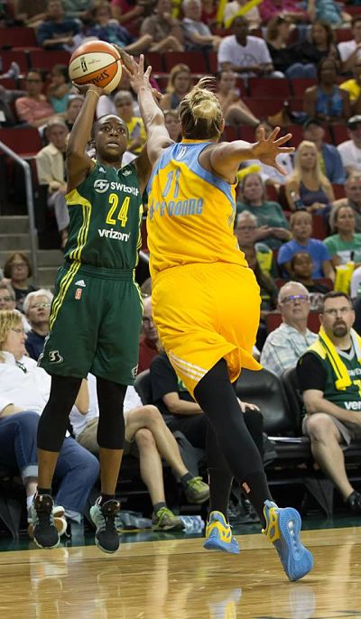 Jewell Loyd shoots over the Sky's Elena Delle Donne. Loyd finished with a double-double 12 points, 10 assists, and three rebounds. Photo by Neil Enns/Storm Photos.