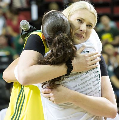 Lauren Jackson and Sue Bird embrace. Photo by Neil Enns/Storm Photos.