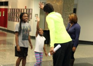 Tamika Catchings high-fives a participant at one of her events. Photo courtesy of Catch the Stars Foundation.