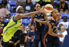 Karima Christmas deflects a pass in a game against the Connecticut Sun. AP Photo/Tony Gutierrez