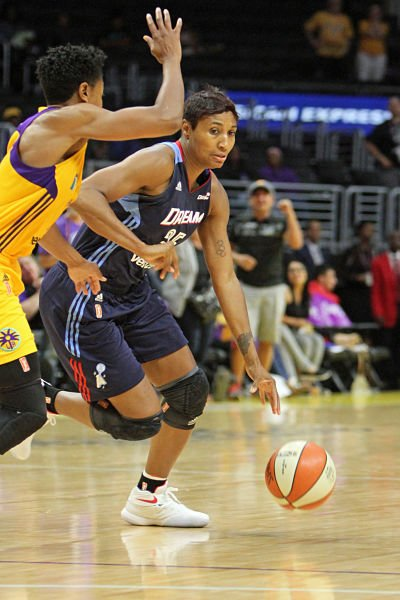 Angel McCoughtry drives past Alana Beard. Photo by Ken Brooks/TGsportstv1/