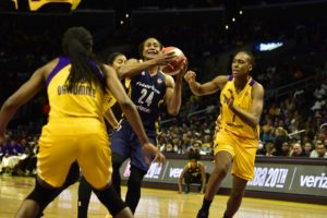 Tamika Catchings goes to the rack against Nneka Ogwumike and Sandrine Gruda. Photo by Mark Hammond.