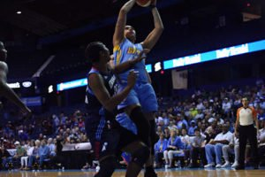 Tamera Young scores over Angel McCoughtry. Photo courtesy of Chicago Sky.