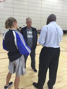 Sue Favor of womenshoopsworld.com and LT Willis of TG Sports TV talk with Sparks coach Brian Agler after the first day of training camp in April. Photo by Los Angeles Sparks media relations.