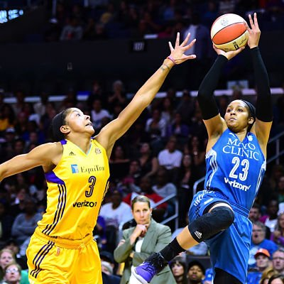 Maya Moore shoots a jumper over Candace Parker in Game 4. Photo by Harry How/Getty Images.
