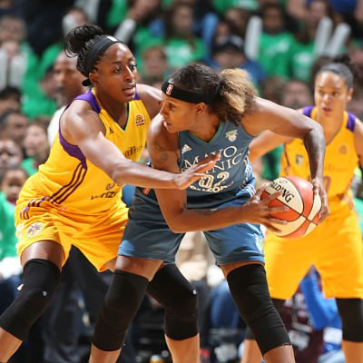 Rebekkah Brunson handles the ball against Nneka Ogwumike. Photo by David Sherman/NBAE via Getty Images.