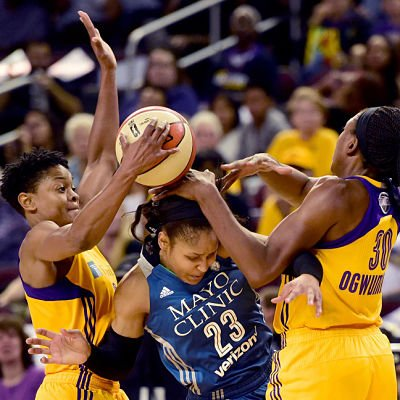 Forward Maya Moore gets trapped by Alana Beard and Nneka Ogwumike. Photo by Harry How/Getty Images.