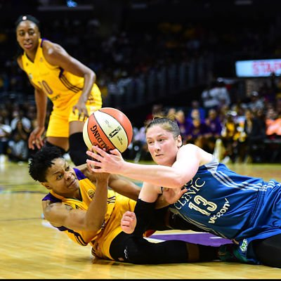 Alana Beard and Lindsay Whalen battle for ball possession. Photo by Harry How/Getty Images.