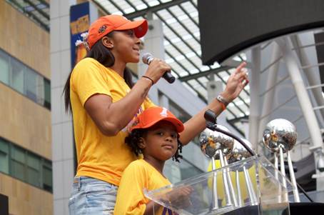 2016 Finals MVP Candace Parker, with daughter Lailaa, addresses the crowd at the Sparks' victory celebration. Photo courtesy of LA Sparks.