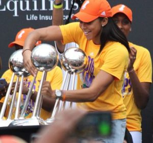 Candace Parker sets the 2016 Championship trophy next to the Sparks' first two. Players used their Championship clout in two strong response videos this week. Photo by Benita West/T.G.Sportstv1.