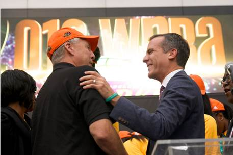 Los Angeles Mayor Eric Garcetti speaks to Sparks coach Brian Agler on stage at the team's victory celebration. Photo courtesy of LA Sparks.