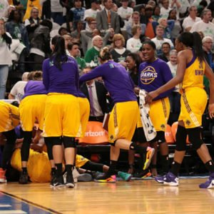 Alana Beard lays on the floor amidst the pandemonium following her shot. Photo by David Sherman/NBAE Getty Images.