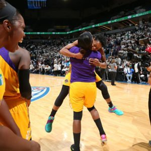 Jantel Lavender hugs Alana Beard after the win. Photo by David Sherman/NBAE Getty Images.