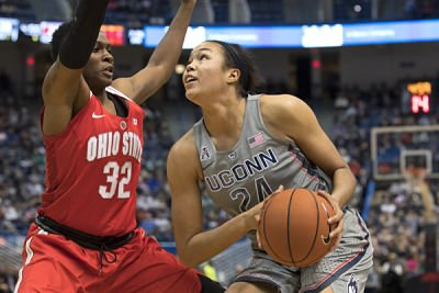 Napheesa Collier looks to get around Shayla Cooper. Photo by Stephen Slade.