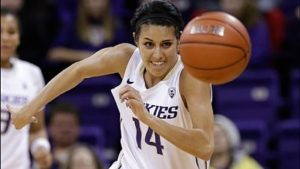 A healthy Heather Corral came off the bench Sunday to score 15 points for the Huskies. Photo by KOMO News.