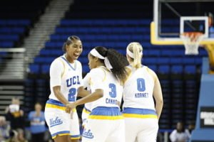 Kelli Hayes, left, congratulates Jordin Canada on a bucket. Hayes put up a career-high 16 points. Photo courtesy of UCLA Athletics.