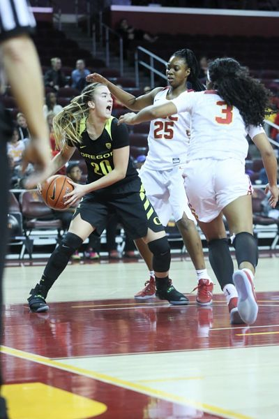 A double-teamed Sabrina Ionescu looks to pass. Photo by Marvin Jimenez.