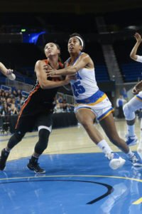 Oregon State's Gabby Hanson and UCLA's Monique Billings battle for a rebound. Photo by Marvin Jimenez.